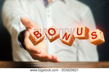 Cubes Thrown By A Man Make Word Bonus. Receive Bonuses, Rewards And Preferences. Salary Increase, Wa