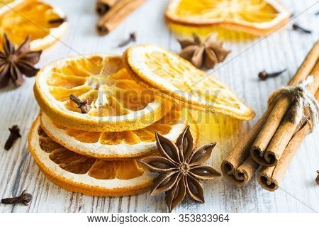 Christmas Spices - Cinnamon Sticks, Star Anise, Cloves And Slices Of Dried Orange On Old Wooden Back
