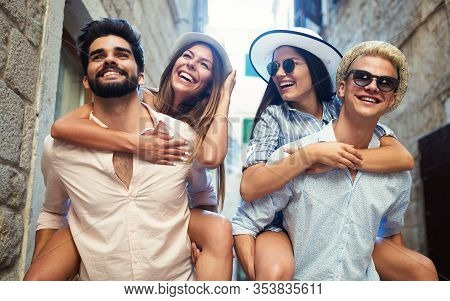 Group Of Young Friends Hangout On City Street