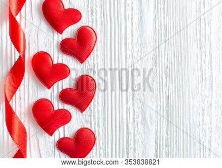 Red Hearts And Ribbon On White Wooden Background. Valentines Day,  Mothers Day, Woman's Day Backgrou