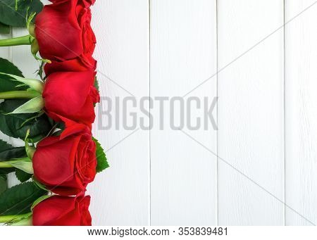 Red Roses On White Wooden Background. Valentines Day,  Mothers Day, Woman's Day Background. Flat Lay