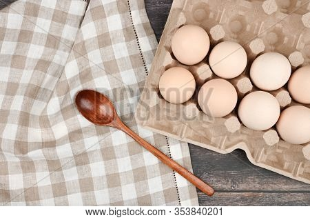 A Tray With Eggs On A Wooden Table. View From Above. Eco Tray With Eggs On A Wooden Table, Minimalis