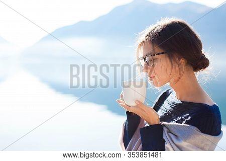 Woman Drinking Coffee At Sea Beach. Cozy Winter Picnic. Girl Enjoying Morning Tea, Life, Travel, Rel