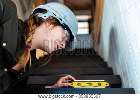 Selective Focus And Close Up On Women Inspector Reviews Closely A Stair Surface With A Spirit Level.
