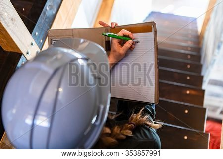 Top View Of Construction Inspector Woman Sits On The Stairs During A Home Pre-purchase Inspection, S