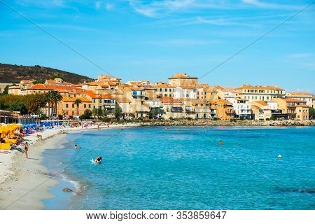 ILE-ROUSSE, FRANCE - SEPTEMBER 22, 2018: People enjoying at the main beach of Ile-Rousse, in Corsica, France, in the late summer