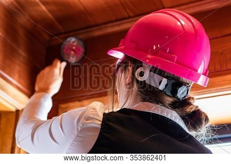 Close Up Back View Of Women Inspector During Indoor Air Quality Inspection, Looking For Molds Or Fun