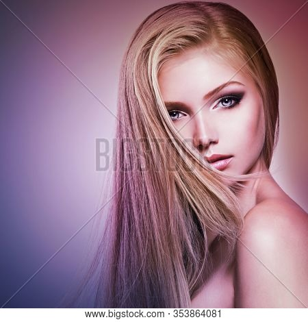 Pretty  face of young woman with long white hair.   Closeup portrait of a pretty girl over creative colored background.
