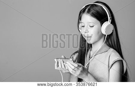 Self Education. Mp3 Player. Small Girl Pupil In Headphones. Child Study Online. E Learning With Eboo