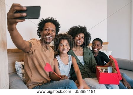 Family Taking Selfie With Phone While Celebrating Mother's Day.