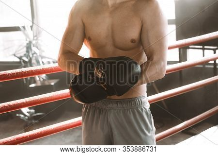 Boxing And Sports Concept. Athlete Boxer With Leather Box Equipment In Boxing Ring. Boxer Wears Boxi