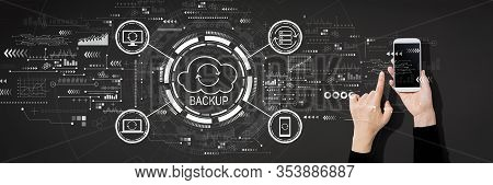 Backup Concept With Person Using A White Smartphone