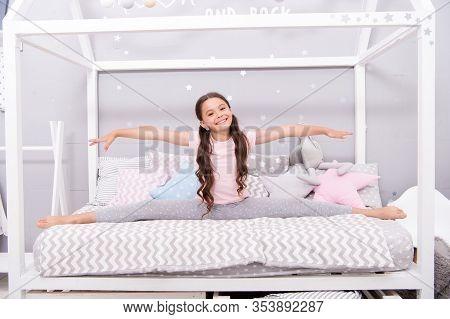 Adorable Gymnast. Happy Child Sit In Split Position. Little Girl Do Split In Bed. Cross Split. Stret