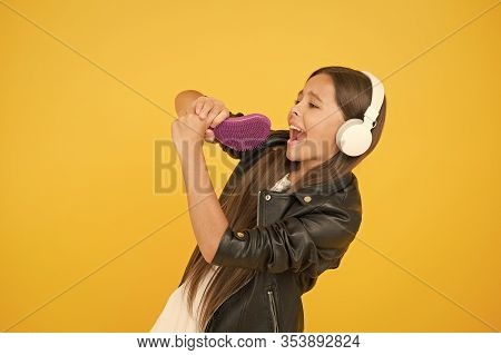 Voice Synthesis Will Change The Way Music Distribution Works. Small Girl Listening Music Headphones.