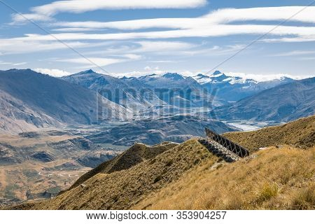 Photovoltaic Solar Panels In Mount Aspiring National Park With Mt Aspiring In Distance, Southern Alp