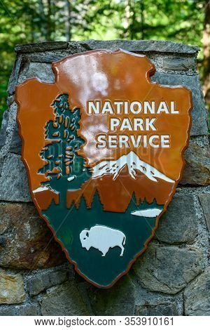 North Cascades National Park, United States: July 31, 2019: National Park Service Sign On A Stone Pi