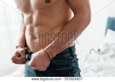 Cropped View Of Submissive And Handcuffed Man In Bedroom