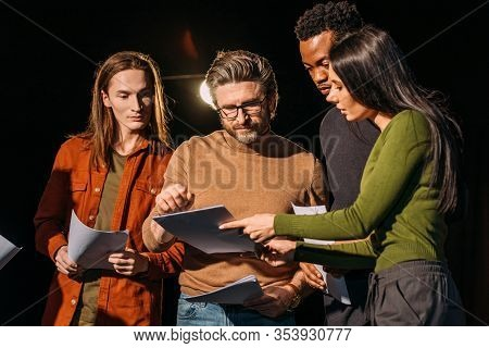 Theater Director, Multicultural Actors And Actress Rehearsing With Scripts On Stage