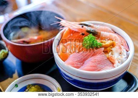Close Up Sashimi Served Fresh Salmon Set With Hot  Miso Soup On Tray ,soft Blur Focus To Sashimi Bow