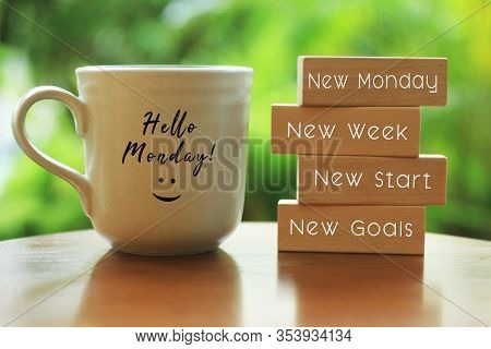 Hello Monday Concept With Inspirational Quote On Wooden Blocks - New Monday. New Week, New Start. Ne