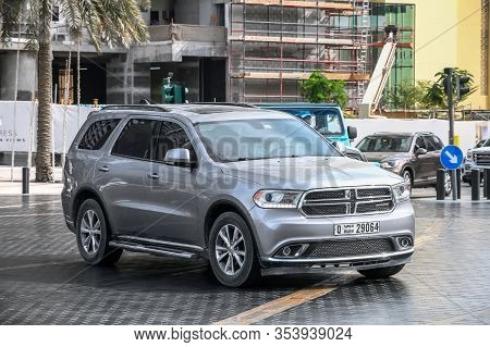 Dubai, Uae - November 16, 2018: Grey Luxury Car Dodge Durango In The City Street.