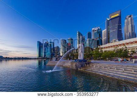 SINGAPORE CITY SINGAPORE: FEBRUARY 15 2020: Singapore Merlion Park downtown Singapore  business district at sunrise