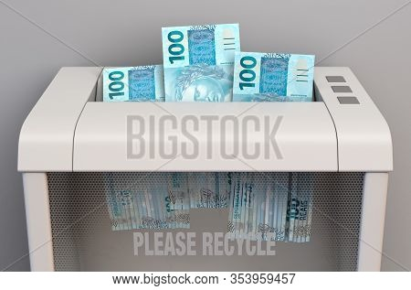 A Regular Office Paper Shredder In The Process Of Shredding Three Brazilian Real Bank Notes On An Is
