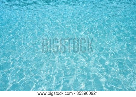 Abstract Image Of Top View Of Shiny Wave Of Clear Blue Sea Water Over Sand Beach, For Beautiful Back