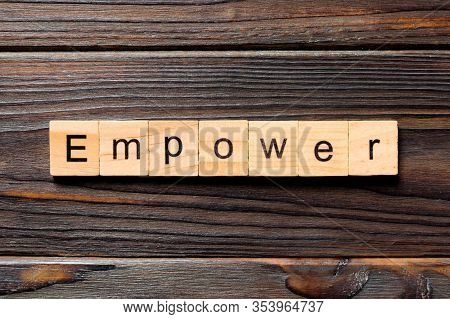 Empower Word Written On Wood Block. Empower Text On Table, Concept