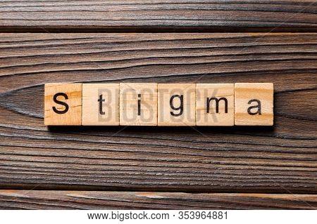 Stigma Word Written On Wood Block. Stigma Text On Table, Concept