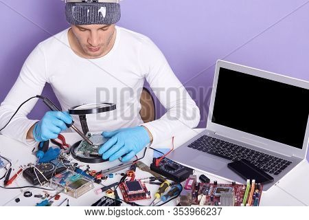 Image Of Man Using Magnifier While Looking On Wires Of Pc, Concentrated Male Working In Electronic L