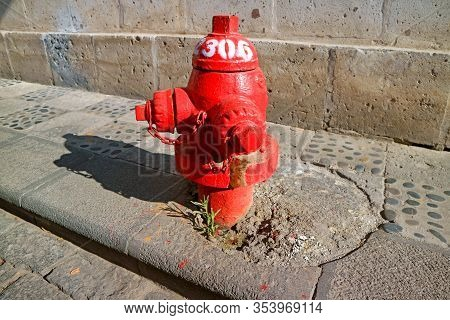 Red Fire Hydrant On The Sidewalk Of The Old City Of Arequipa, Peru, South America