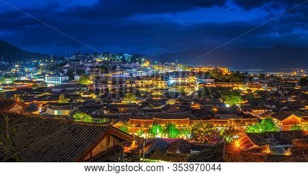 Panorama Top View Scene Of Ancient Lijiang Old Town At Twilight Time, Is The Historical Center Of Li