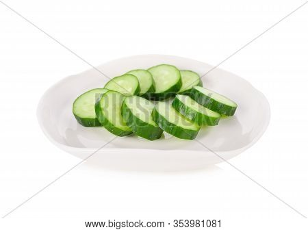 Sliced Fresh Japanese Cucumbers In White Plate On White Background