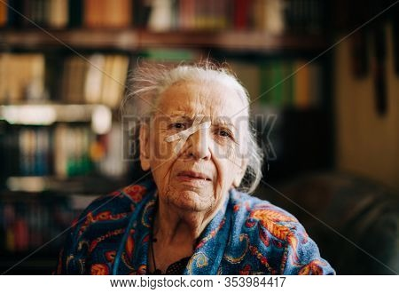 real senior woman at home , natural light , selective focus point