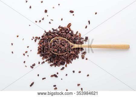 Cacao Nibs On Wood Spoon, White Background