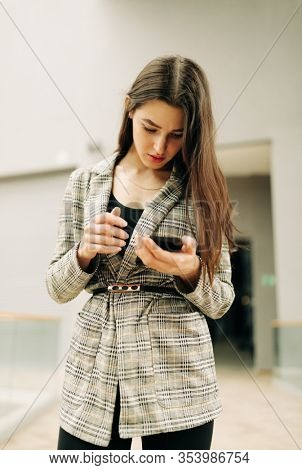 portrait of Real Young pretty woman with cell-phone