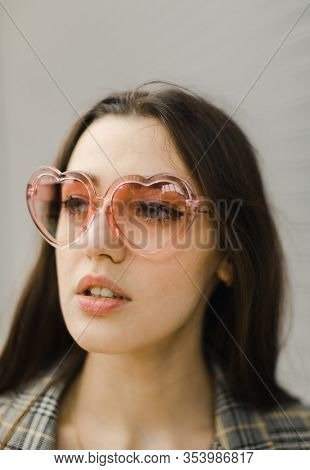 woman with pink sunglasses,  selective focus, natural light