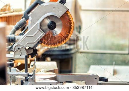 Professional Compound Mitre Circular Saw At Emnty Woodcraft Carpentry Workshop. Carpenter Woodworks