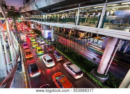 Bangkok, Thailand: Concrete Flyovers For Pedestrians And Cars Driving In Lights Of Modern Shopping M
