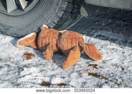 Childrens Accident On A Winter Road, Bunny Rabbit Toy. Death On The Road, Carelessness And Danger. A