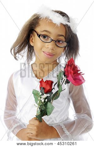 A dressy, young elementary girl happily carrying red roses.  On a white background.