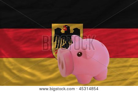Piggy Rich Bank And  National Flag Of Germany