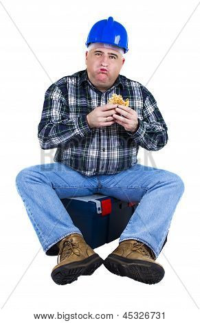 Worker With A Mouthful Of Hamburger
