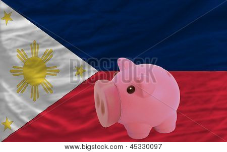 Piggy Rich Bank And  National Flag Of Philippines