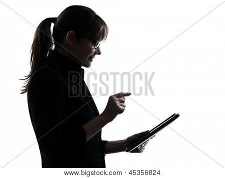 one business woman computer computing typing digital tablet  silhouette studio isolated on white background