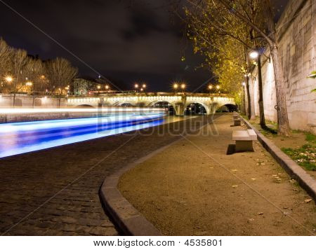 Fly-boat Cruising On The River Seine By Night.