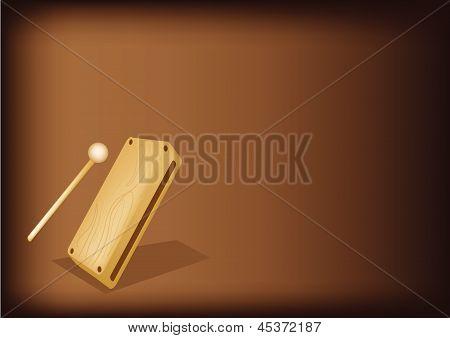 A Musical Wood Block On Dark Brown Background