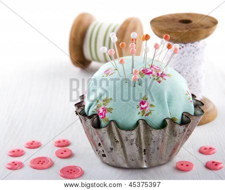 Pincushion In An Old Metal Cupcake