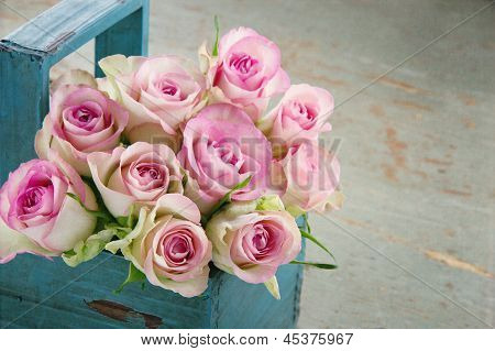 Roses In An Old Blue Wooden Basket